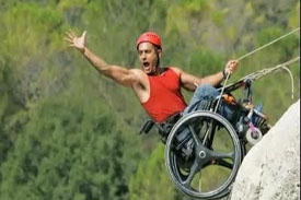 Man in wheelchair rock-climbing